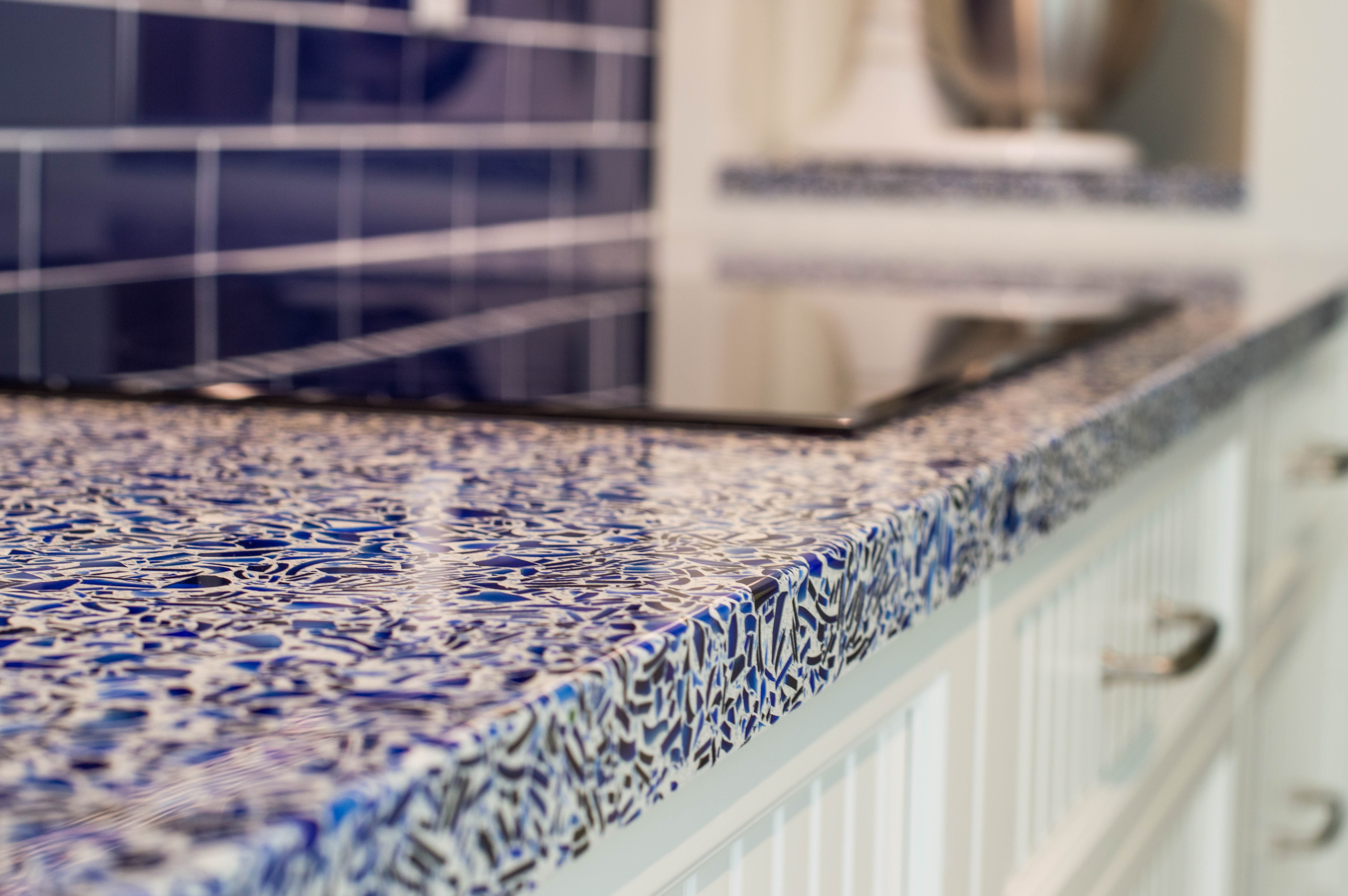 2-cobalt skye vetrazzo recycled glass countertops designed by waterview kitchens featuring crystal cabinets